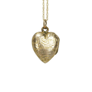 vintage gold heart necklace with feathers and leaves