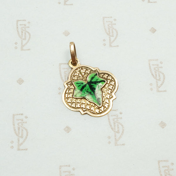 realistically enameled ivy leaf on an embellished 14k rose gold pendant