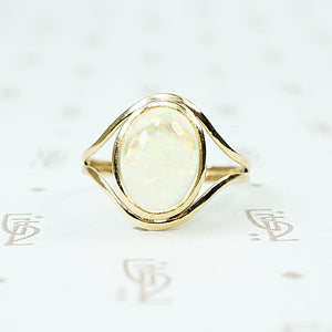 Jelly Opal set in 14k recycled yellow gold ring