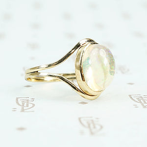Jelly Opal set in 14k recycled yellow gold ring side view