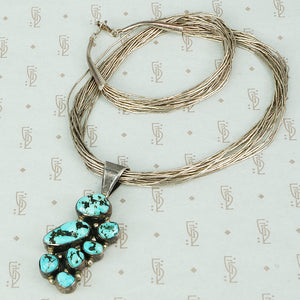 liquid silver necklace with kingman turquoise pendant