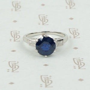 Intense Sapphire and Baguette Platinum Engagement Ring