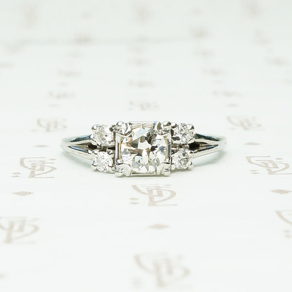 double diamond sides flank a square set round diamond in 14k white gold engagement ring