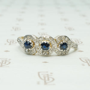 triple infinity sapphire and rose cut diamonf ring