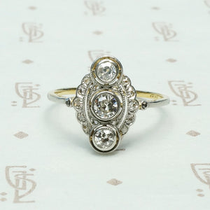 edwardian 3 diamond bezel set platinum on 18k marquis shaped ring