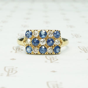 cornflower blue sapphires alternate with little round diamonds in the pavé rectangle 18k yellow gold ring from chester england