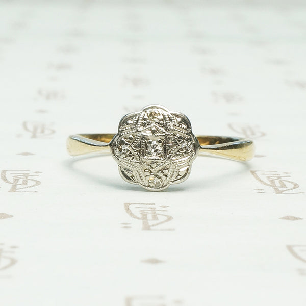 platinum on 9k yellow gold highly detailed flower shaped top with tiny diamonds