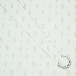 18k white gold crescent moon necklace set with round diamonds