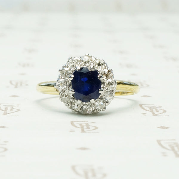 chunky omc diamond halo around oval blue sapphire in 18k yellow gold and platinum ring circa 1930