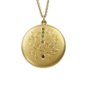 Antique Round Locket with hand engraved flowers and paste gems