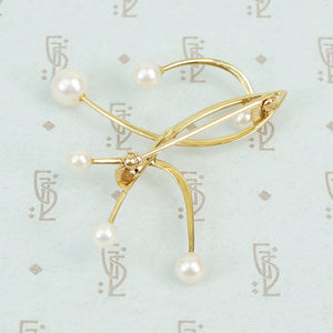 The Curve a Mid Mod Gold and Pearl Brooch