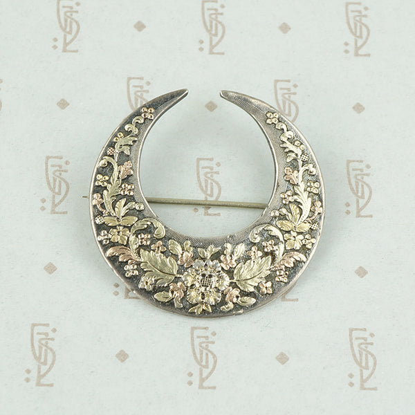 victorian crescent moon brooch with applied rose and green gold flowers