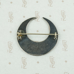 back of moon and flowers brooch showing c clasp