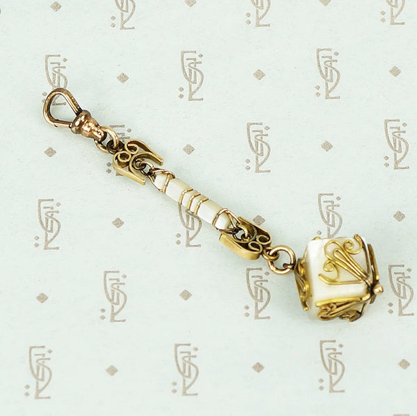 mother of pearl and gold fill fob on a hook