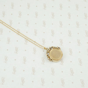 Back view of gold filled compass necklace