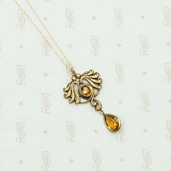Art Nouveau Citrine and Flowing Gold Pendant