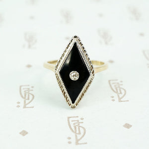 2 tone gold onyx and diamond ring