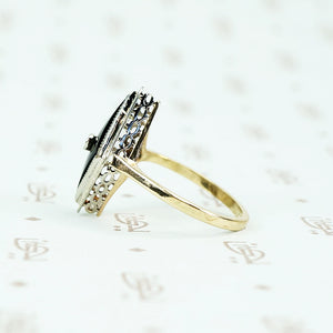 2 tone gold onyx and diamond ring side view