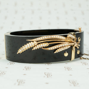onyx bangle bracelet with a gold and pearl sheaf of wheat antique