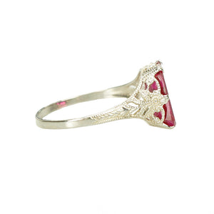 side detail view of otsby and barton white gold filigree ring set with syn ruby