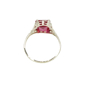 detail view of white gold filigree red ruby ring