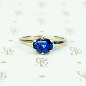 recycled white gold solitaire with oval 1.06 carat blue sapphire