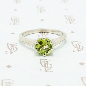 1 carat green peridot solitaire in recycled white gold