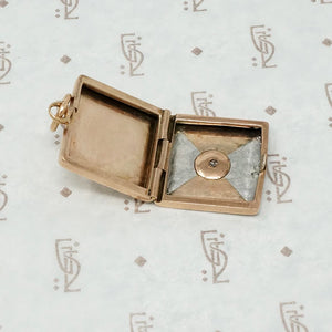platinum and rose gold locket with omc diamond open