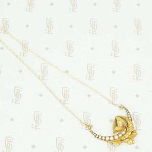 gold vintage crescent moon and poppy necklace