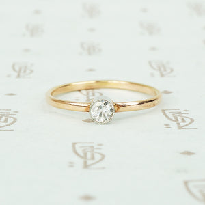 recycled rose gold and bezel platinum tiny diamond engagement ring