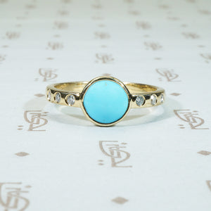 sleeping beauty turquoise in 14k recycled yellow gold with diamond sides