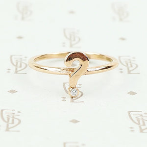 The question mark ring in rose gold with diamond by 720.
