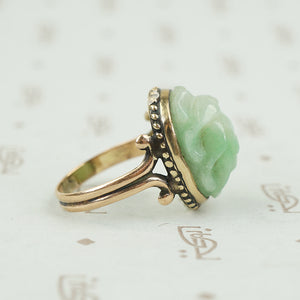 side detail of carved light green jade scarab ring