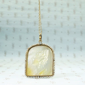 "Carved mother of pearl ""Rosario"" pendant with seed pearl surround and rose cut diamond detailssilver and 14k yellow gold"