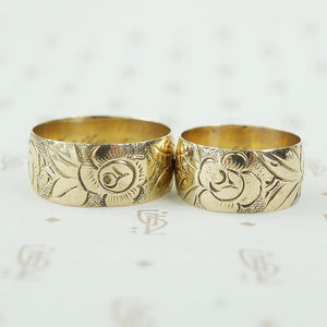 matched pair of wedding bands with roses