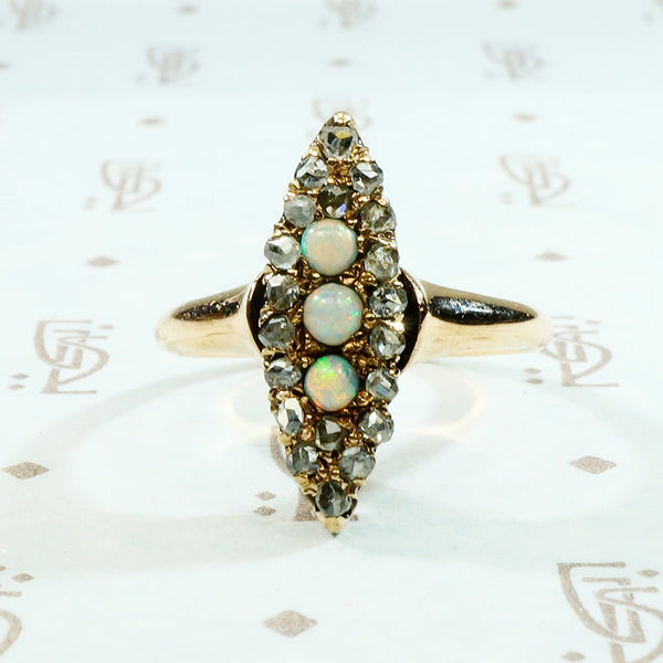 opal and rose cut diamond navette ring in rose gold