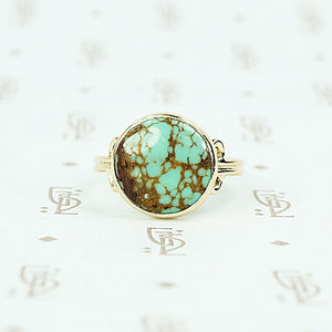 round turquoise in 14k gold specimen ring