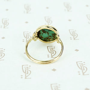 round turquoise in 14k gold specimen ring back view