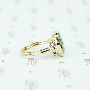 round turquoise in 14k gold specimen ring side view
