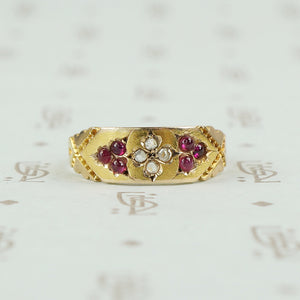 hallmarked 15ct gold band with diamonds and rubies