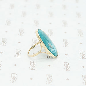 gold and turquoise ring side view