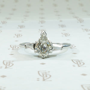 Dramatic Shield Cut Diamond Platinum Engagement Ring