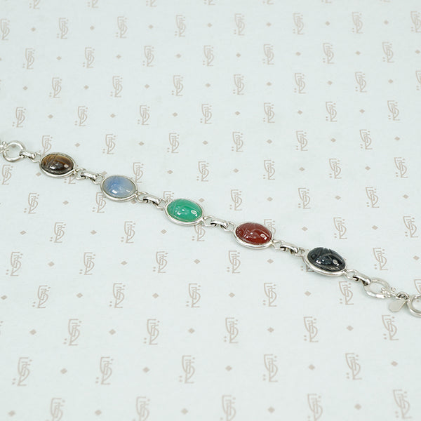 1950's sterling silver bracelet with semi precious stone scarabs