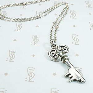 Sweet Scrolled Silver Key Pendant