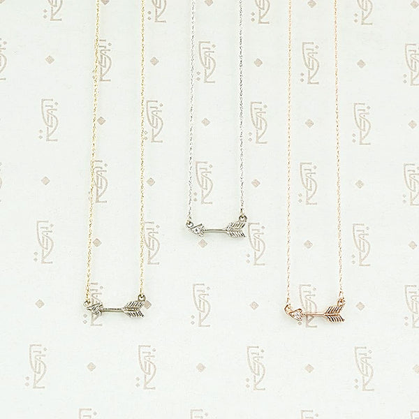 The Tiny Arrow Necklace in Recycled Gold by 720