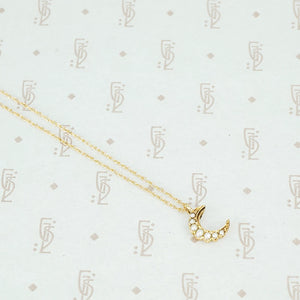tiny gold crescent moon with pearls