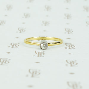 18k and platinum omc tiny diamond ring