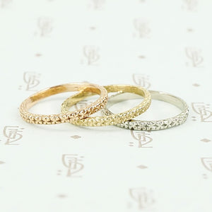 Treasure Recycled Revival band in yellow, white and rose gold.