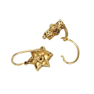 back and side detail of gold pinwheel shaped victorian small earrings