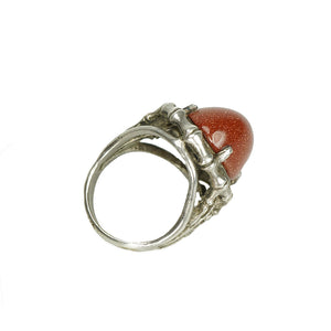 sterling silver ring with goldstone set in a bone shaped frame